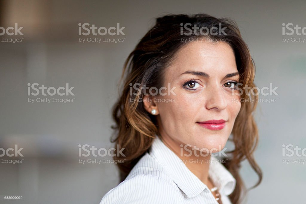 Spanish Businesswoman Serious At the Camera. At the office. stock photo