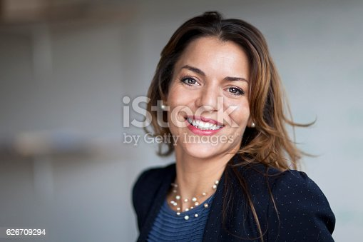 istock Spanish Businesswoman Smiling At the Camera. At the office. 626709294