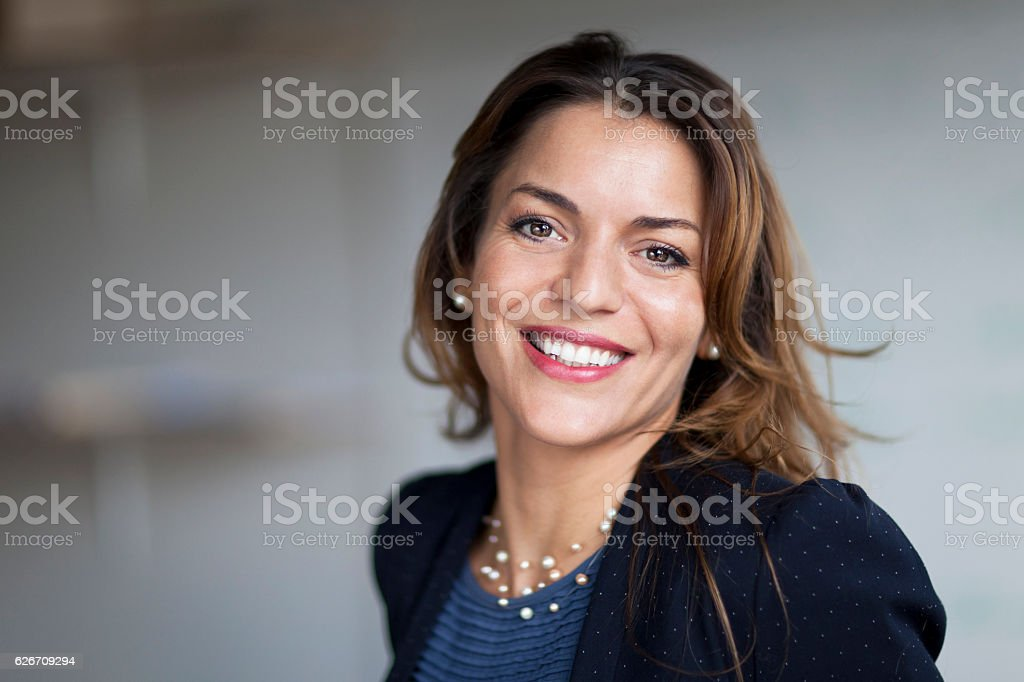 Spanish Businesswoman Smiling At the Camera. At the office. - foto de stock