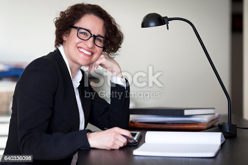 istock Spanish Businesswoman Smiling At the Camera. At the office. 640336098