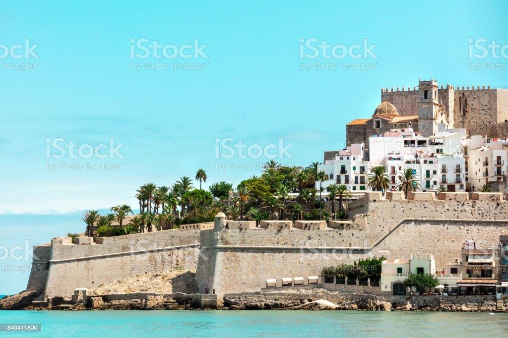 Spanish castle Peniscola, blue sea, teal blue sky stock photo