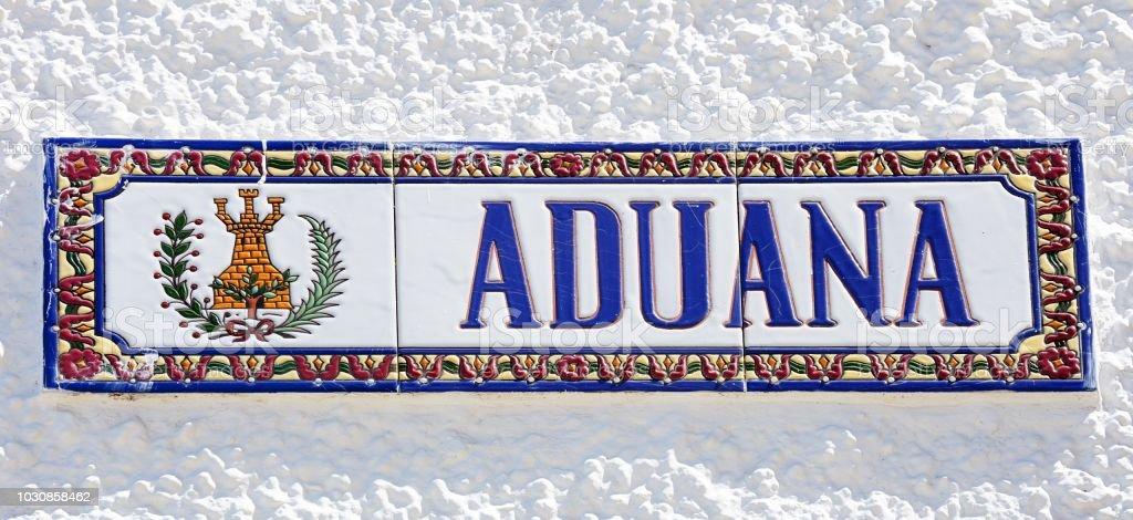 Spanish ceramic customs sign, Ayamonte, Spain. stock photo