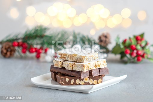 istock Spanish Christmas sweets turron and bright light in the background 1281604785