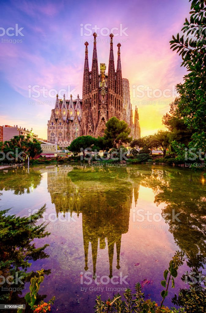 Spanish Cities Barcelona la Sagrada familia sunset clouds blue hour flare stock photo