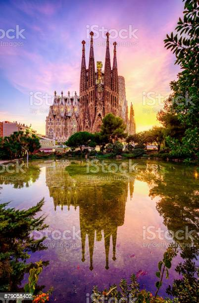 Photo of Spanish Cities Barcelona la Sagrada familia sunset clouds blue hour flare