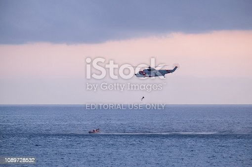 Gran Canaria, Spain - April 6, 2017: A Spanish Sea King Coastguard helicopter on a training manoeuvre off the coast of Gran Canaria.