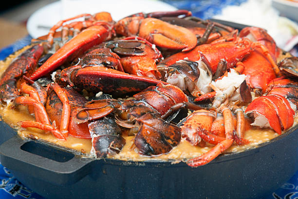 Spanish Cuisine Paella Arroz caldoso Spanish Cuisine, Paella de arroz coldoso witg homard. Caldereta arroz stock pictures, royalty-free photos & images