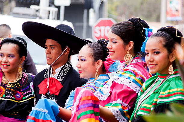spanish dancers posing for the crowd - cinco de mayo stock photos and pictures