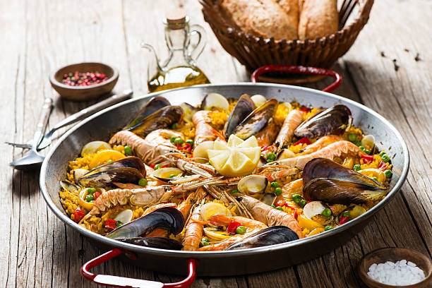 spanish dish paella with seafood - paella stock photos and pictures