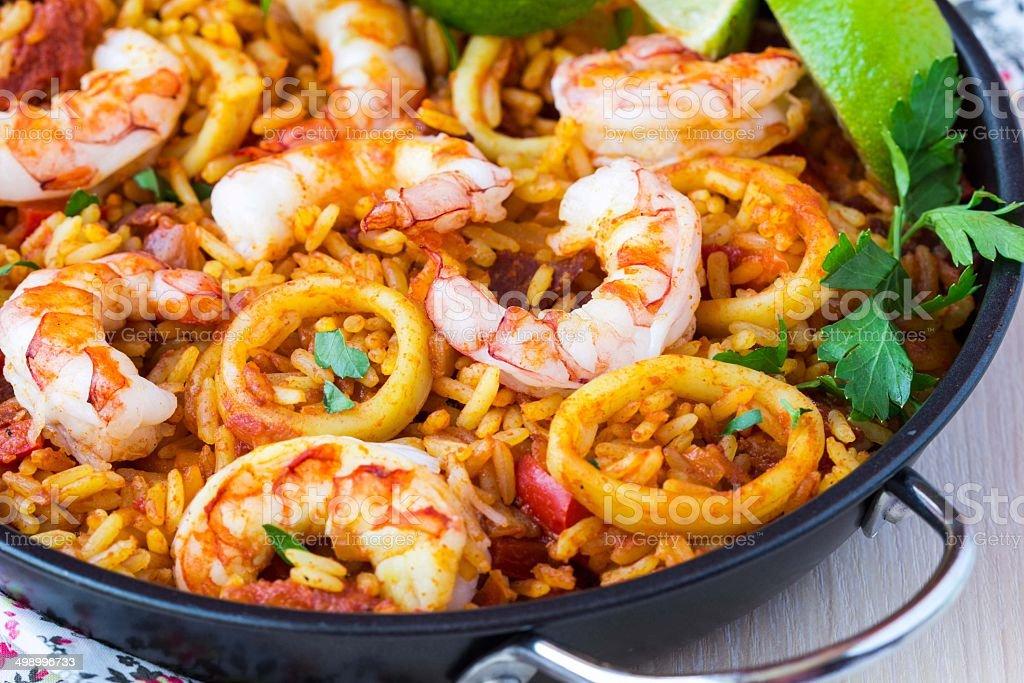 Spanish dish paella with seafood, shrimps, squid, rice, saffron stock photo