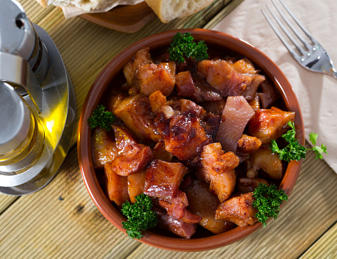 Spanish dish - roasted pig nose and cheeks