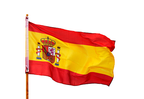 Spanish flag in the wind isolated on white background