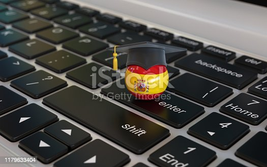 1069581886 istock photo Spanish flag with graduation cap on laptop keyboard 1179633404