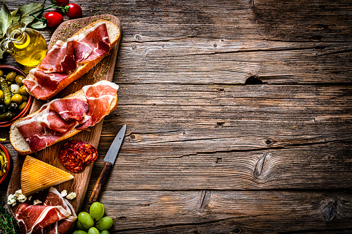 Spanish food: overhead view of two bread slices with Iberico ham also called