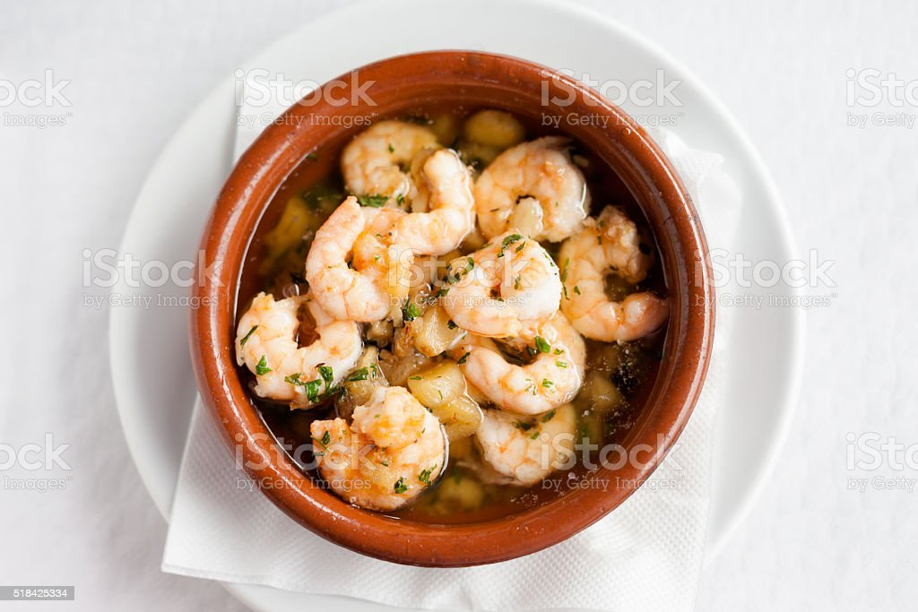 Spanish garlic shrimp in pot stock photo