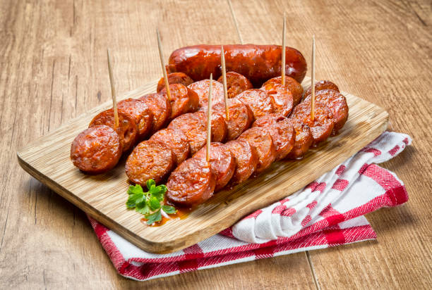 spanish grilled sausage - sausage stock photos and pictures