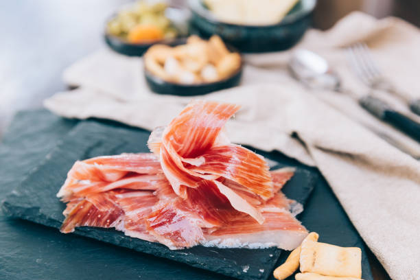 Spanish ham over black board Spanish ham over black board iberian stock pictures, royalty-free photos & images