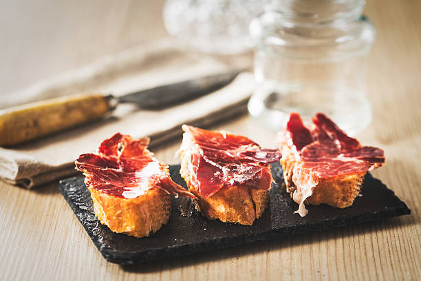 Spanish ham Spanish ham tapas, vintage edition. iberian stock pictures, royalty-free photos & images