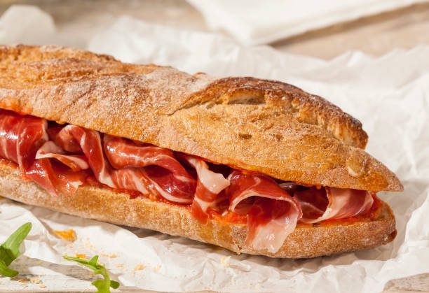 Spanish ham sandwich Crunchy sandwich with Spanish cured ham. iberian stock pictures, royalty-free photos & images