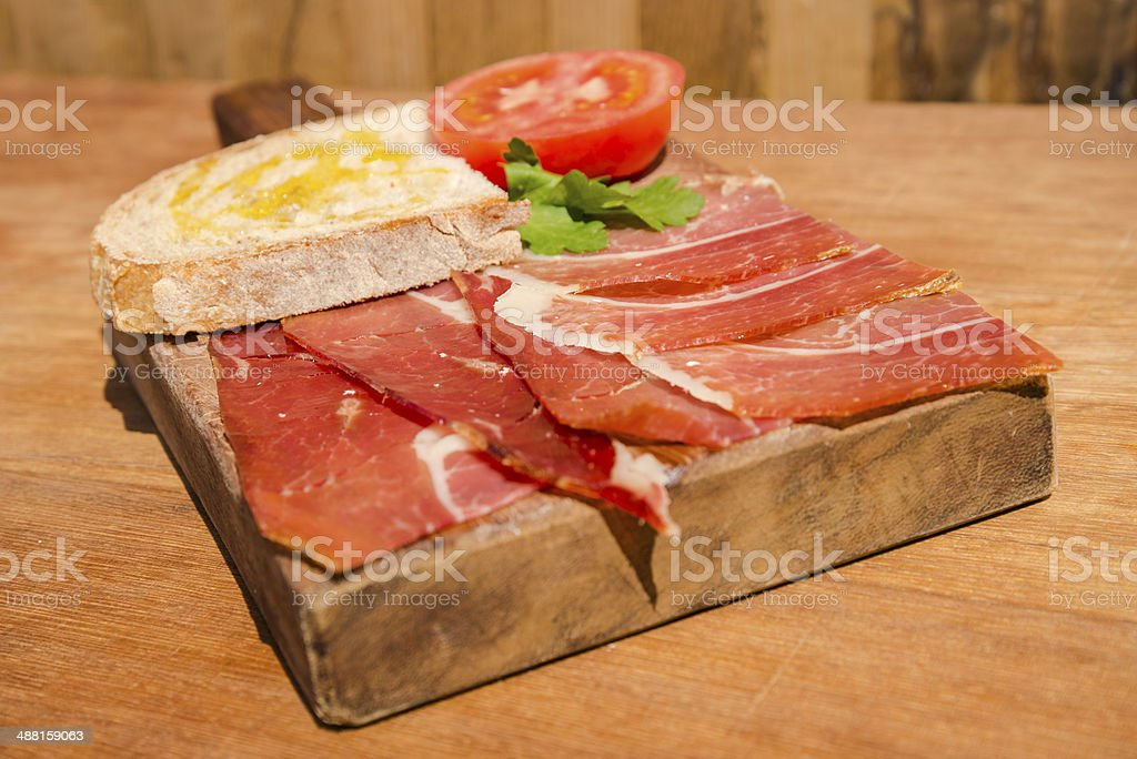 Spanish ham with bread, olive oil and tomato stock photo