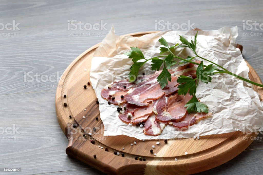 Spanish hamon ready for eat ovet the wooden background royalty-free stock photo