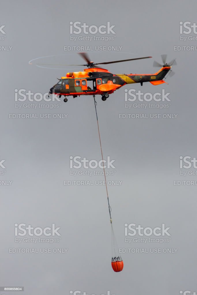 Spanish helicopter bambi-bucket fire fighting stock photo