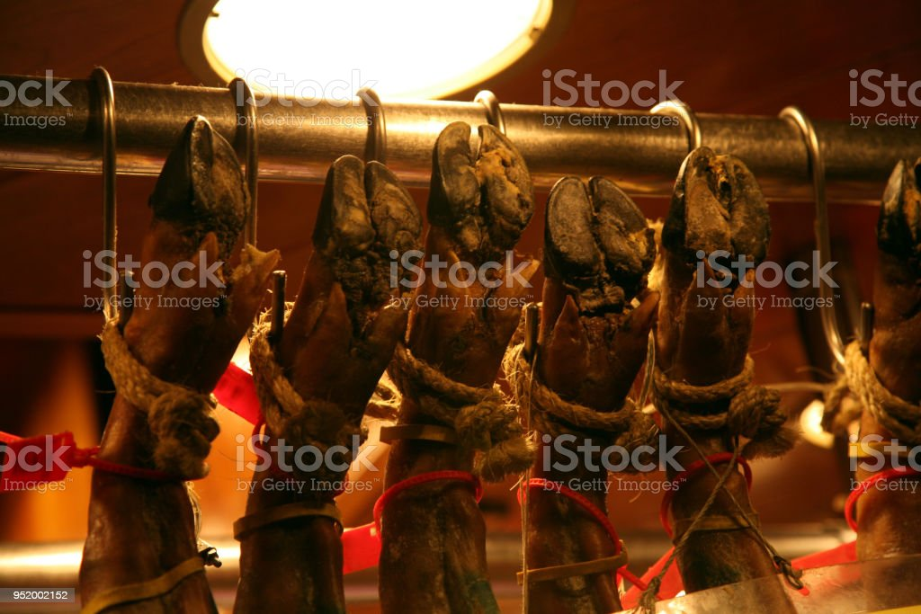 Spanish jamon - traditional national spain meat hanging on the hook...
