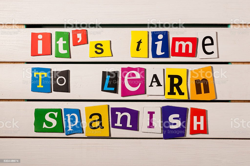 Spanish language learning concept image. It's time to learn stock photo