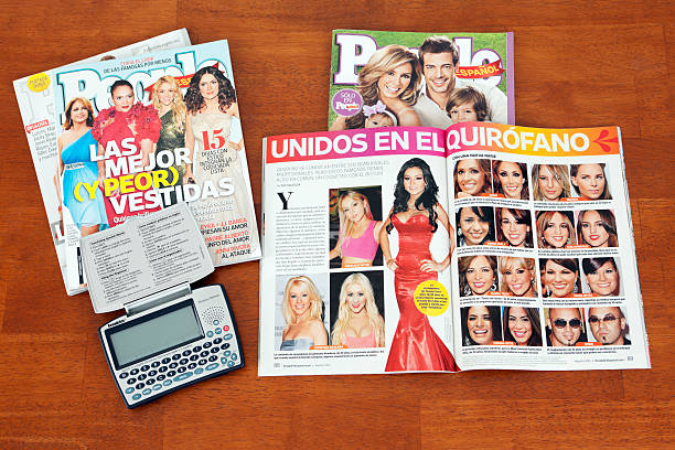 Spanish Magazines with Translator/Dictionary Chillicothe, Ohio, USA - August 10, 2011: Franklin Merriam Webster Spanish English dictionary and People in Espanol magazines on a wooden coffee table. This electronic dictionary allows the user to translate from English to Spanish or from Spanish to English.  People in Espanol magazine is an American magazine written in Spanish. This weekly magazine features celebrity and human interest stories and is published by Time Inc. time magazine stock pictures, royalty-free photos & images