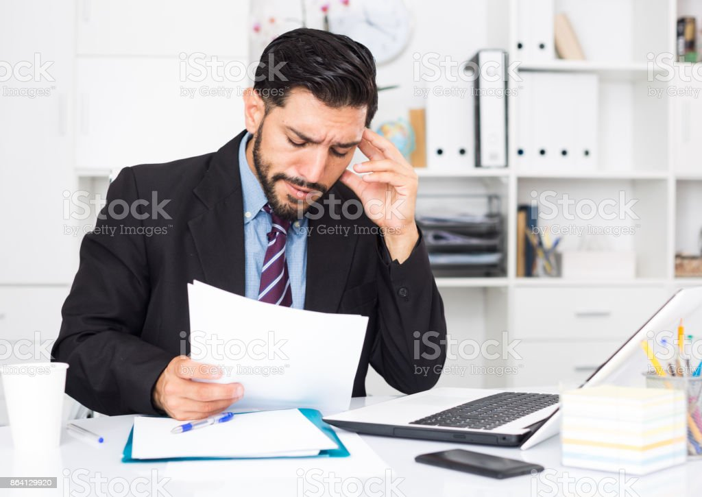 Spanish male worker is having complicated issue with project royalty-free stock photo