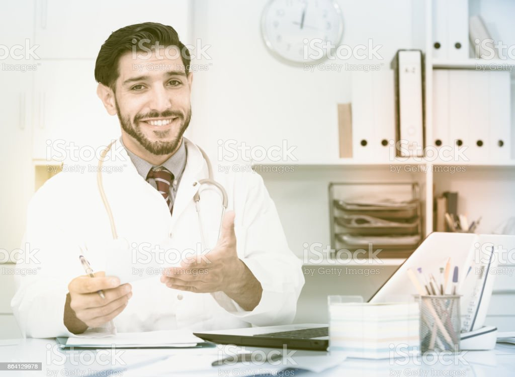 Spanish man therapist is giving opinion to client royalty-free stock photo