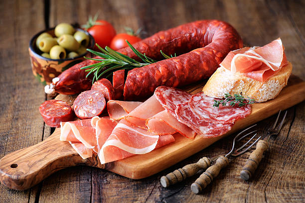 spanish meat tapas - sausage stock photos and pictures