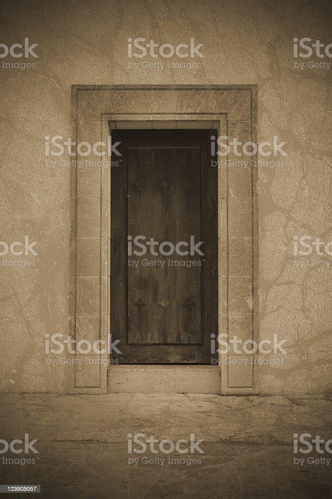 Spanish Mission-Style Door - Sepia stock photo