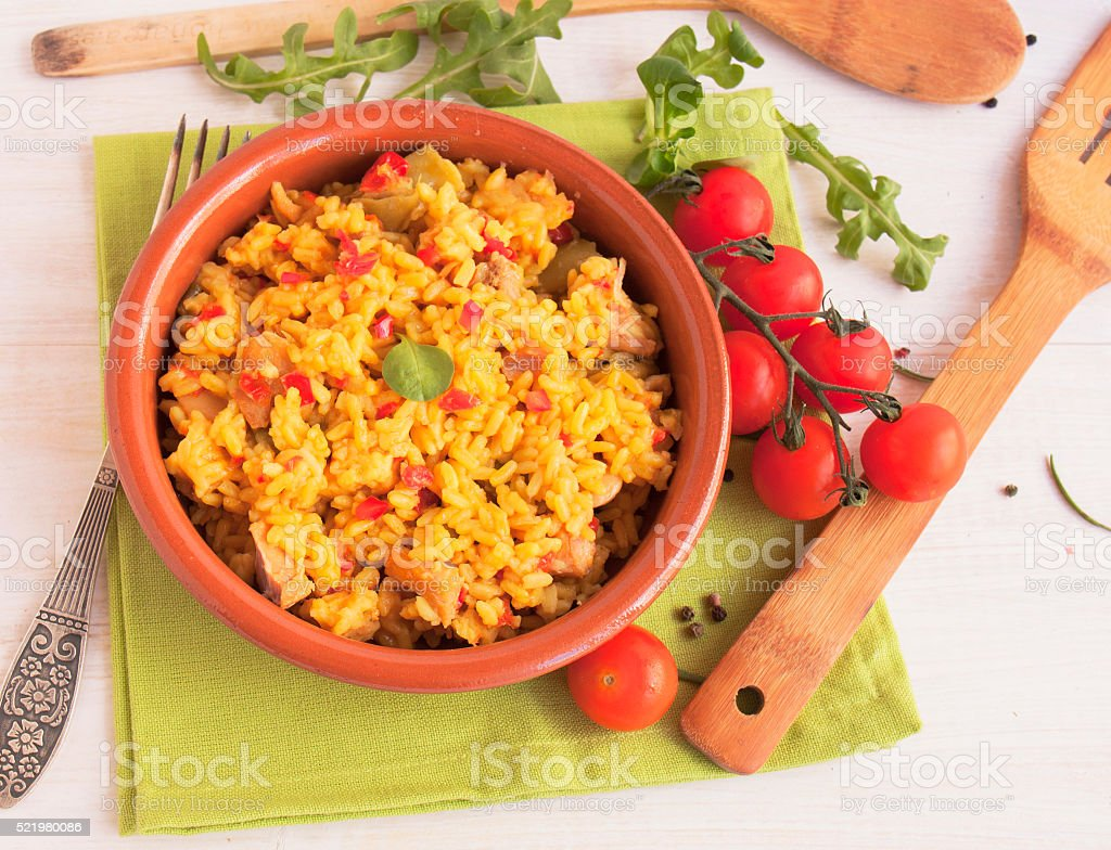 Spanish paella in a clay plate stock photo