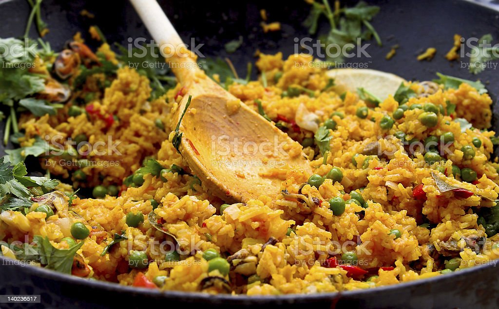 Spanish paella plate being prepared stock photo