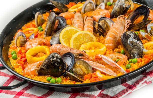 spanish paella, valencia - paella stock photos and pictures