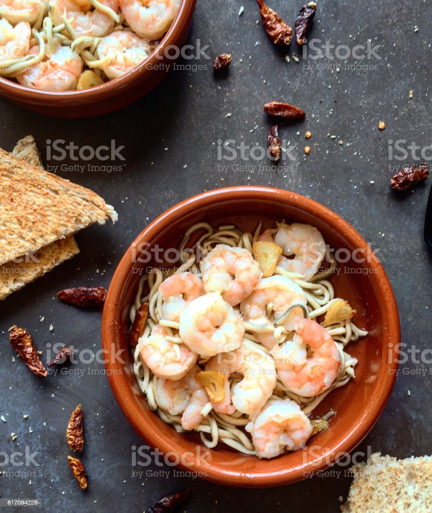 Spanish prawns al ajillo and gulas. stock photo