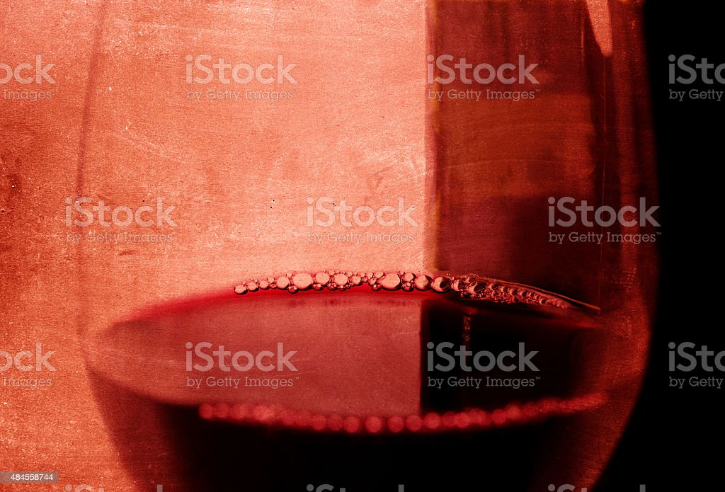 Spanish red wine Glass with bubbles and bottle arty background stock photo