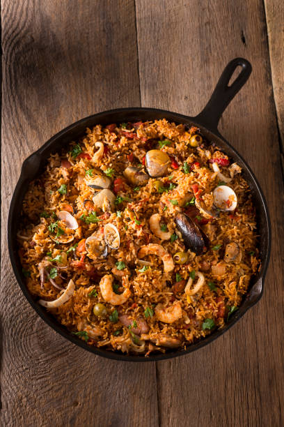 spanish seafood - paella stock photos and pictures