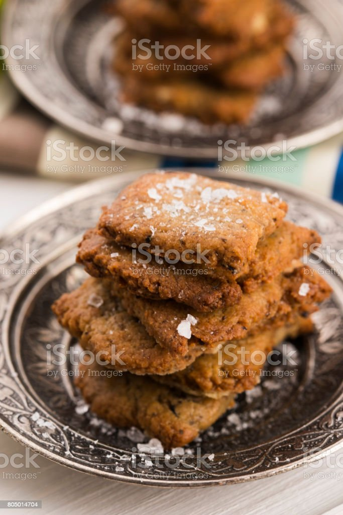 spanish snack crackers with black olives and anchois stock photo