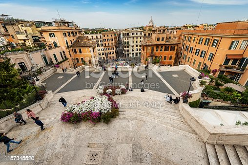 Rome, Italy - April 22th, 2019: Spanish steps and the Piazza di Spagna with the Fontana della Barcaccia and the famous Via dei Condotti. Rome, UNESCO world heritage site, Latium, Italy, Europe. A group of tourists visit the famous monuments.