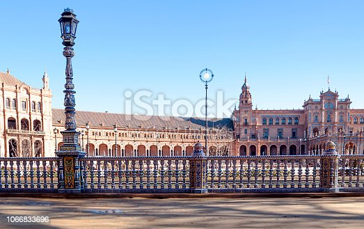 Sevilla, Spain - May 18, 2013: Wide-angle view of a crowded Plaza de España in Seville, Spain, a square built in 1928 for the Ibero-Amercian Exposition of 1929 in Regionalism style, that mixes elements of the Renaissance Revival and Neo-Mudejar styles.