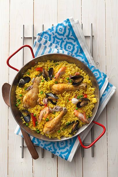 spanish stills: paella - paella stock photos and pictures
