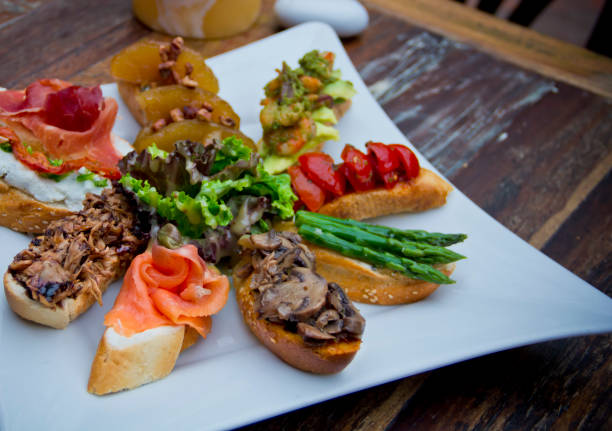 spanish tapas assortment - spanish food stock photos and pictures