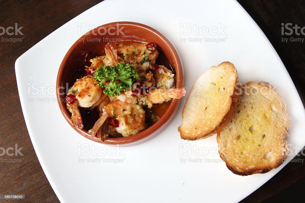 Spanish tapas dish, sizzling prawns with chili and garlic stock photo