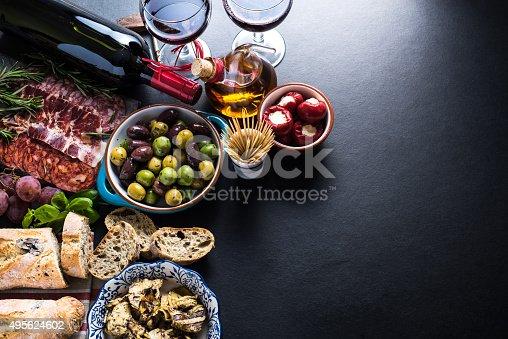 istock spanish tapas , food border background 495624602