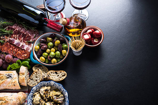spanish tapas , food border background - spanish food stock photos and pictures