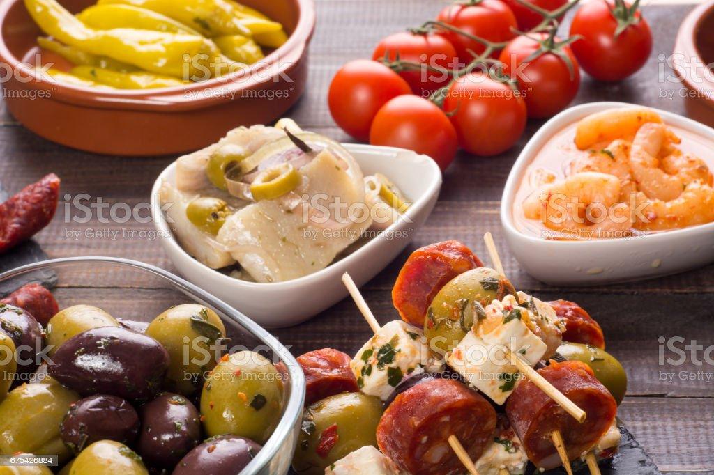 Spanish tapas starters on wooden table photo libre de droits