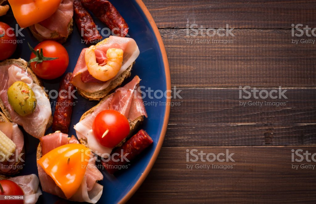 Spanish tapas starters on wooden table royalty-free stock photo