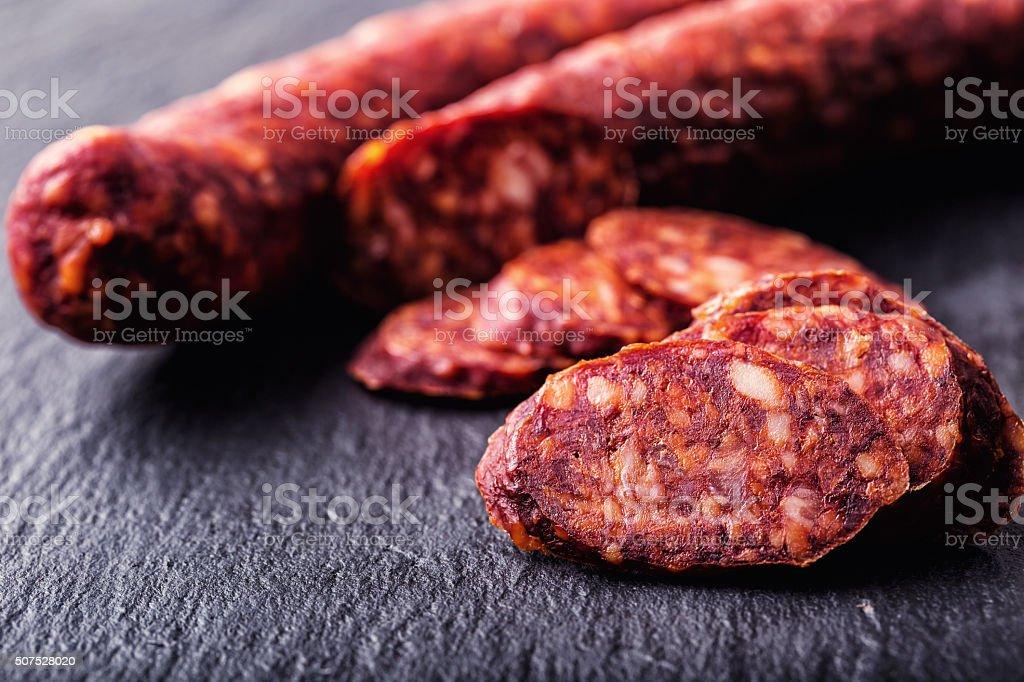 Spanish traditional chorizo sausage, with fresh herbs, garlic, pepper. stock photo